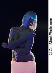 Charming topless girl posing with luminous makeup