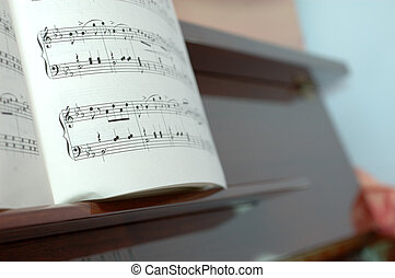 Music notes on piano - Music notes on a piano