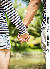 Lovely couple hold the hands