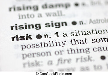 Definition of risk - A close up of the word risk from a...