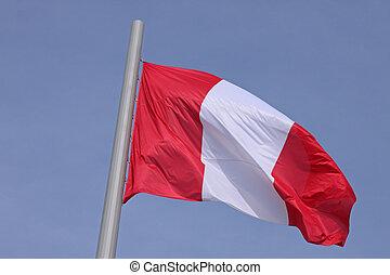 flag of Peru over blue sky