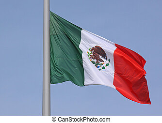 flag of Mexico over blue sky