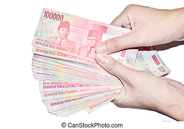 woman hand holding money Indonesia, isolated on white...
