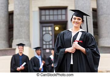 pretty female graduate at college graduation