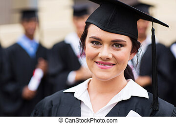 happy female graduate at graduation ceremony