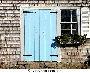 blue - light blue door with window cape cod house