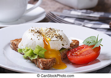sandwich with open poached egg and coffee horizontal -...