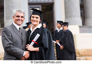 female graduate with her father