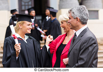 female graduate with parents - happy female university...
