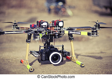 Octocopter drone ready to takeoff - Preparing to take aero...