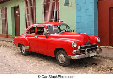 Cuban taxi - Bright red old fashioned, retro, taxi cab with...