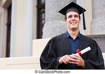 male graduate outside college building - cheerful male...