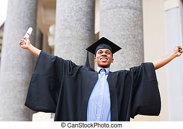 african male graduate holding his diploma - cheerful african...