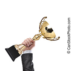Winner - Businessman holding a champion golden trophy