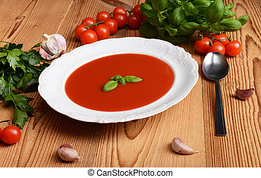 Tomato soup - Tasty tomato soup on wooden background