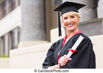 middle aged woman with graduation cap and gown