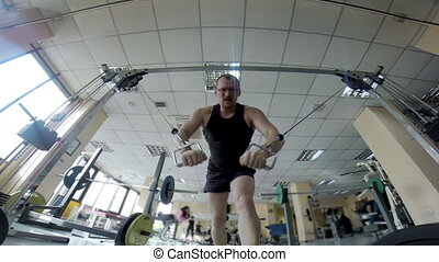 Training in the Gym - Man is engaged in the gym