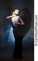 Voluptuous woman posing similitude of fallen angel - Image...