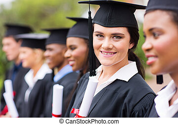 female college graduate at graduation - smiling female...