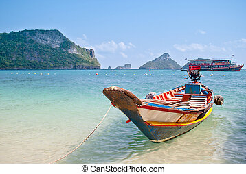 Tropical beach, traditional long tail boats at Angthong...