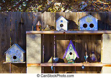 shelves in the garden with collection of bird houses