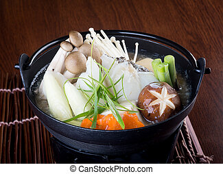 japanese cuisine. hot pot on the background - japanese...