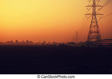 High voltage poles - electricity post on rice fields in the...