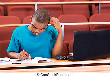 young african american college student studying in lecture...