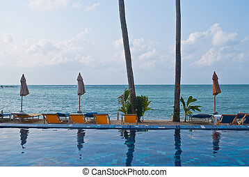 Nice tropical pool beside the sea, summer time at Koh Samui,...