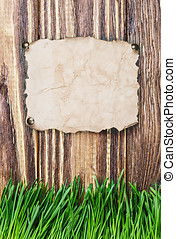 paper hanging on a wooden fence - old paper hanging on a...