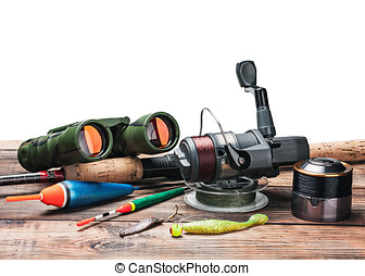 fishing tackle on the table isolated on white background