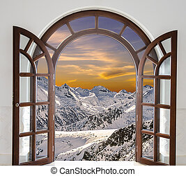 Arch door opened with views of the peaks of snowy mountains...