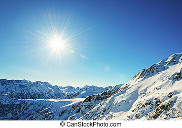Winter mountain landscape against the blue sky Peaks of...