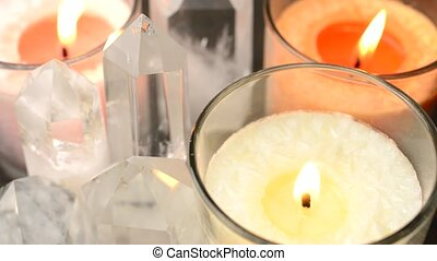 Crystals and candles - Close up of quartz crystals aligned...