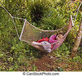 girl sleeping in a hammock