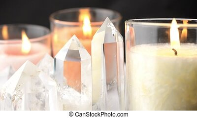 Crystals and candles - Close up of quartz crystals lined and...