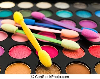 multicolored eye shadows and cosmetics brush - multicolored...
