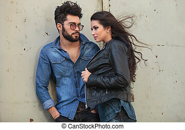 young casual couple pose in the wind