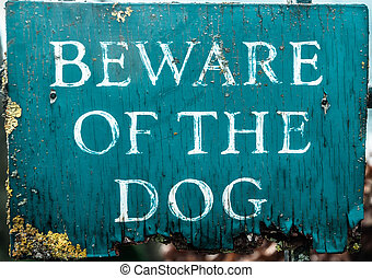 Beware Dog Sign - Old and neglected wooden beware of the dog...