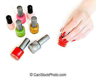 manicure - vials of nail varnish on the table in a beauty...
