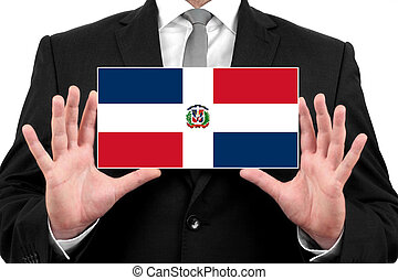Businessman holding a business card with Dominican Republic...