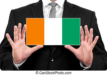 Businessman holding a business card with Ivory Coast Flag