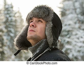 man in a fur winter hat