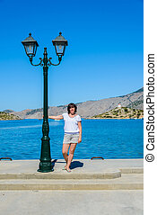 woman on the waterfront - middle-aged woman posing on the...