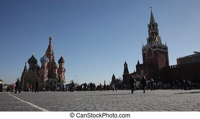 Tourists near St. Basil's Cathedral. St. Basil's Cathedral ? the orthodox temple located on Red Square in Moscow