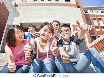 happy students thumbs up  together