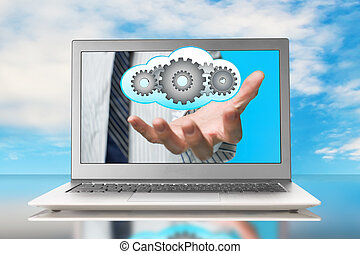 Hand holding cloud gears inside with blue sky background
