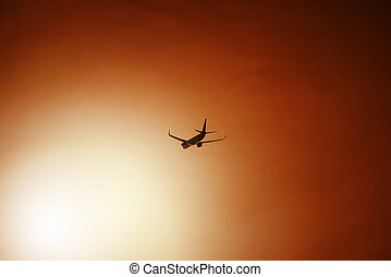 Airliner after take off during sunset - Passenger aeroplane...