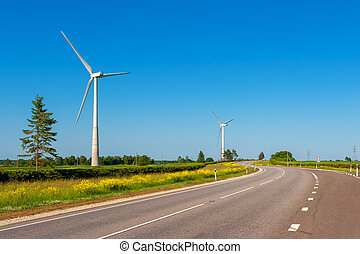 Wind turbines Estonia - Landscape with highway and wind...