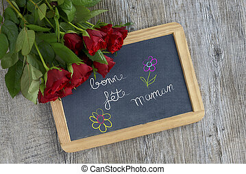writing happy mother's day on the slate